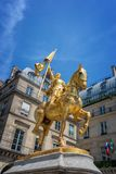Golden statue of Joan of Arc from 1874, place des Pyramides, Paris France. Golden statue of Joan of Arc from 1874, place des Pyramides, in Paris France Royalty Free Stock Image