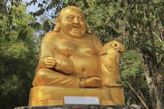 Golden Statue Katyayana are wealthy symbol. In the temple Royalty Free Stock Image