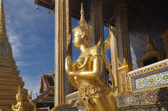 Golden statue of Kinare at Wat Phra Kaew or The Emerald Buddha temple in Bangkok, Thailand Royalty Free Stock Images