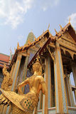 Golden statue of a Kinnara guarding Wat Phra Kaew Royalty Free Stock Images