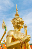 Golden statue of Kinnara Stock Photography