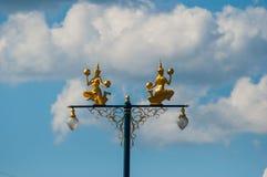 Golden statue on the lighting pole. Taken in Kanchanaburi, Thailand Stock Photos