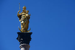 The Golden statue of Mary (Mariensaule), a Marian column on the. Marienplatz in Munich, German Royalty Free Stock Photo