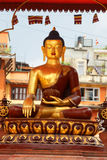 Golden statue of a meditating Buddha Stock Photography