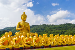 Golden statue of monks and buddha Stock Images