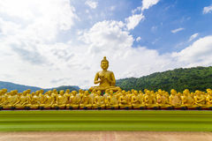Golden statue of monks and buddha Stock Photo