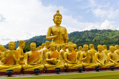 Golden statue of monks and buddha Stock Photography