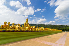 Golden statue of monks and buddha Royalty Free Stock Image