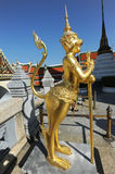 Golden statue of mythical creature Stock Photos