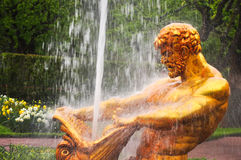 Golden statue of the Peterhof Palace in Saint Petersburg, Russia Royalty Free Stock Photos
