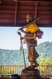 Golden statue of Phra Sivali, an arhat widely venerated among Theravada Buddhists. Sīvali is typically depicted standing upright. And carrying a walking staff Stock Photography