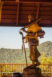 Golden statue of Phra Sivali, an arhat widely venerated among Theravada Buddhists. Sīvali is typically depicted standing upright. And carrying a walking staff Royalty Free Stock Photography