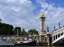 Golden Statue on Pont Alexandre III, Grand Palais Roof, View from Siene River Stock Photography