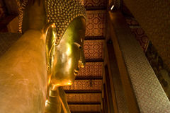 Golden Statue of Reclining Buddha, Thailand Royalty Free Stock Images