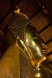 Golden Statue of Reclining Buddha, Thailand. Golden statue of reclining Buddha, Wat Pho, Bangkok, Thailand Royalty Free Stock Photo