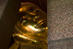 Golden Statue of Reclining Buddha, Thailand. Golden statue of reclining Buddha, Wat Pho, Bangkok, Thailand Royalty Free Stock Photos