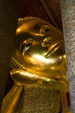 Golden Statue of Reclining Buddha, Thailand. Golden statue of reclining Buddha, Wat Pho, Bangkok, Thailand Royalty Free Stock Images