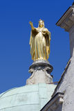 Golden statue of Saint Anne on the Cathedral of Apt, France Royalty Free Stock Image