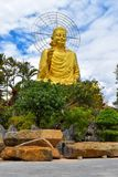 Golden Statue of Sakyamuni Buddha at Van Hanh Pagoda in Da Lat, Vietnam. It is 24 m high, 20 m wide, right hand holding a lotus. It was build in 2002 Stock Photo
