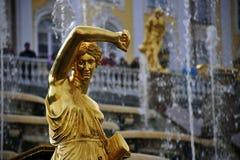 Golden Statue, St. Petersburg, Russia. A golden statue greets visitors at the Peterhof Estate outside St. Petersburg, Russia Royalty Free Stock Photography