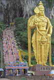 Golden statue and staircase to Batu caves Royalty Free Stock Photo