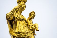 Golden statue of the Virgin Mary in the city center of Munich, Germany Royalty Free Stock Photos