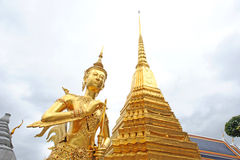 Golden Statue at Wat Phar Kaew Stock Photo