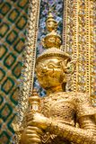 Golden statue at the Wat Phra Kaew Palace, also known as the Emerald Buddha Temple. Bangkok, Thailand. royalty free stock images