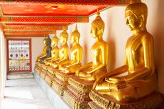 Golden statue in Wat Po Temple Stock Images
