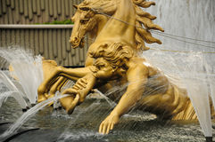 Golden statue water fountain Stock Images