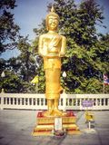 Golden statue week of worship in Thailand. Tourism. Wednesday royalty free stock photo