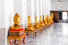 Golden statues of Buddha in a bright temple in Bangkok, Stock Photo