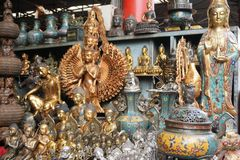 Golden statues of buddha and shiva in flea market in Beijing China stock images