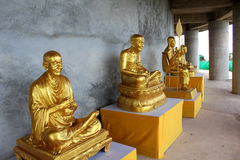 Golden statues of Buddhist abbots stock photography