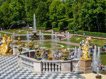 Golden statues and fountains in Peterhof Palace Stock Photos