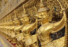 Golden sculptures of garuda Royalty Free Stock Image