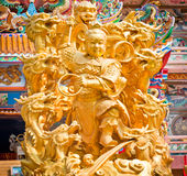 Golden statues of gods Stock Photography