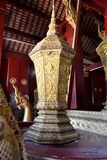 Golden Statues Murals and Carving in the Buddhist Temples of Luang Prabang Laos Royalty Free Stock Photo