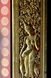 Golden Statues Murals and Carving in the Buddhist Temples of Luang Prabang Laos Stock Photography
