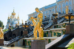Golden statues in Peterhof Palace Stock Photo