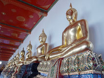 Golden Statues in a Thai Buddhist Temple. In the Grand Palace in Bangkok Royalty Free Stock Photo