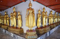 Golden statues at wat pho in bangkok. Golden statues at wat pho temple in bangkok Stock Photos