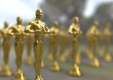 Golden statuette. 3D render image representing a group of Shiny Elegant Golden statuette Stock Photos