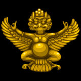 Golden statuette of the deity in Indian style Royalty Free Stock Images