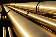 Golden steel pipeline during sunset Royalty Free Stock Photos