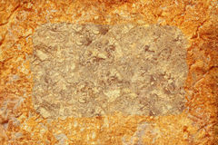Golden stone background. Golden stone wall texture background. Stock photo Royalty Free Stock Photos
