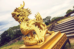 Golden stone dragon statue in Vietnam , Hue, Palace of the Emper Royalty Free Stock Photo