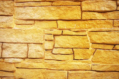 Golden stone wall background. Royalty Free Stock Photos