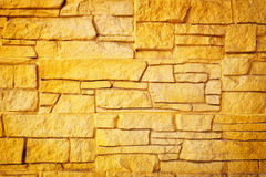Golden stone wall background. Royalty Free Stock Photo