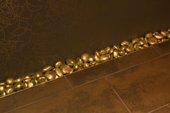 Golden stones and golden tiles Stock Photo